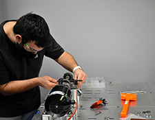 Image of Amazon student working on a motor
