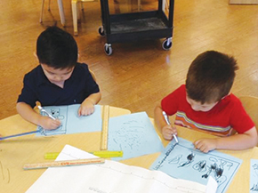 Students writing in LCCC Early Learning Center