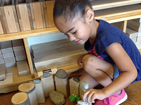 Image of student playing in Early Learning Center