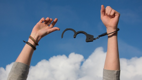 Canva-Hands-in-Handcuffs-on-Sky-Background-(1).jpg