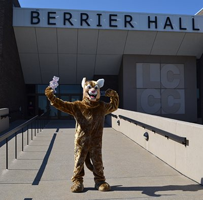 Image of Clawrence in front of Berrier Hall